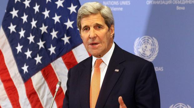 US secretary of state John Kerry confirms Iran has complied with the deal and lifts America's nuclear-related sanctions (AP)