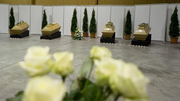 Coffins with the remains of victims of Tuesday's explosion in Istanbul are laid out in a hangar of Berlin Tegel Airport (AP)