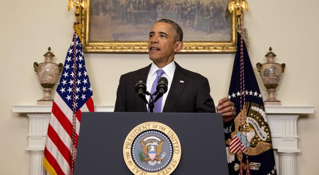 Barack Obama hailed the release of US prisoners, but imposed sanctions on Iran for ballistic missile tests (AP)