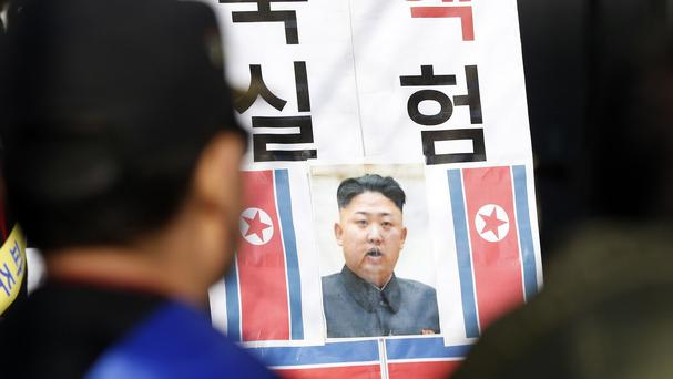 The image of North Korean leader Kim Jong Un with the words 'North Korea Nuclear Test' is displayed during an anti-Pyongyang protest (AP)