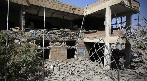 An employee inspects a building destroyed by Saudi-led air strikes in Sanaa, Yemen (AP)