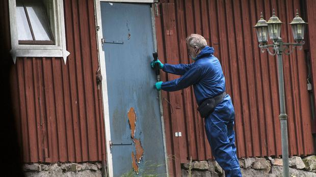 A police forensic officer works at a property outside Knislinge in southern Sweden (Johan Nilsson/TT via AP)