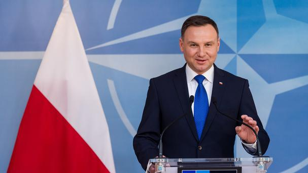 Polish president Andrzej Duda addresses the media at Nato headquarters in Brussels (AP)