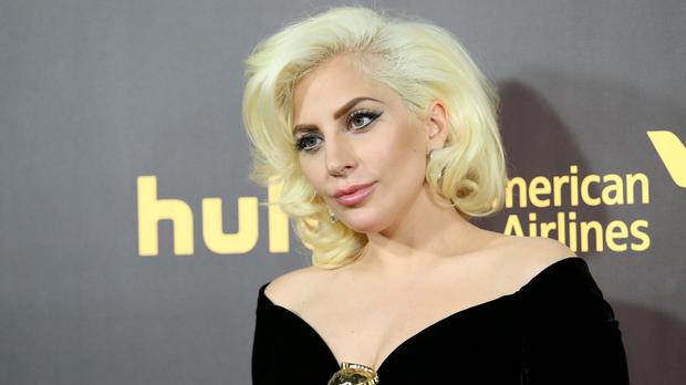 Lady Gaga with her Golden Globe for American Horror Story: Hotel - a producer has apologised for claiming she does not deserve a songwriting credit for the song Til Tt Happens To You (AP)
