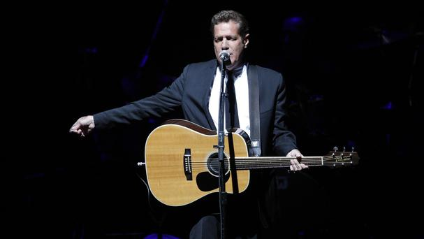 Glenn Frey performing Belfast in 2009 - the Eagles guitarist has died aged 67 (AP)