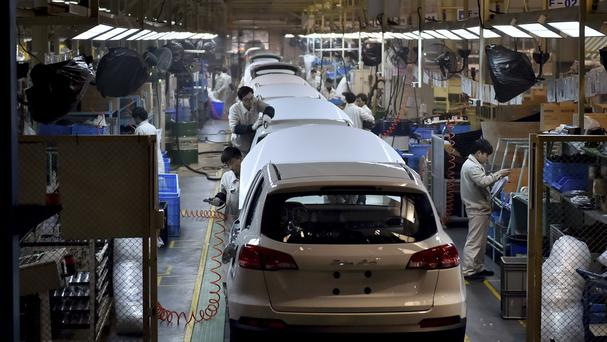 Chinese workers on the assembly line of the X5 SUV of Zotye Auto in Hangzhou in east China's Zhejiang province (AP)
