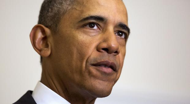 The Supreme Court has agreed to a review of Barack Obama's executive orders to allow up to five million immigrants to work legally in the US (AP)
