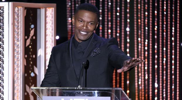 Jamie Foxx told how he helped pull a man from his burning truck (AP)