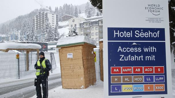 A police officer guards a checkpoint at a hotel during the World Economic Forum in Davos (AP)