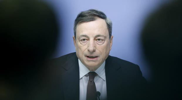 European Central Bank president Mario Draghi speaks during a news conference in Frankfurt, Germany (AP)