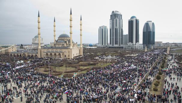 Chechen demonstrators gather for a massive rally in Grozny (AP)