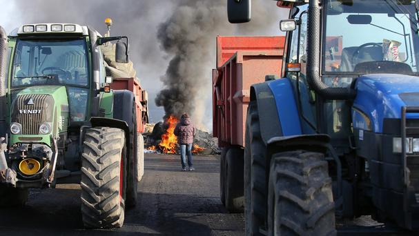 French farmers block the road near Guingamp (AP)