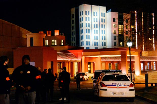 French police officers stand guard after the security alert at a Disneyland Paris hotel