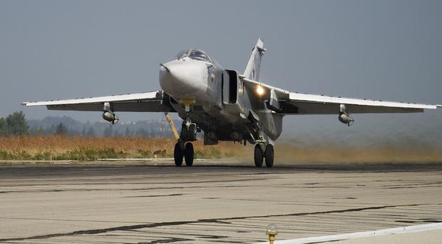 A Russian SU-24 takes off on a combat mission from Syria (AP)