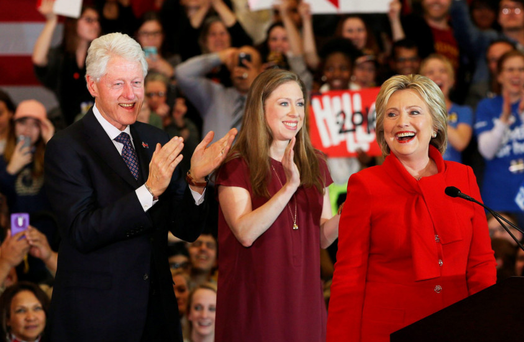 Hillary Clinton with her husband Bill and daughter Chelsea at the caucus in Iowa