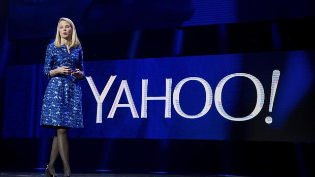 Marissa Mayer announced that Yahoo is laying off about 1,700 employees, but some shareholders believe she should lose her job (AP)