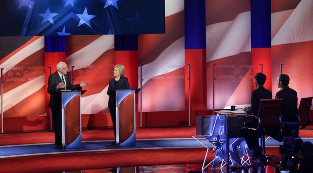 Bernie Sanders and Hillary Clinton at a Democratic presidential primary debate in New Hampshire (AP)