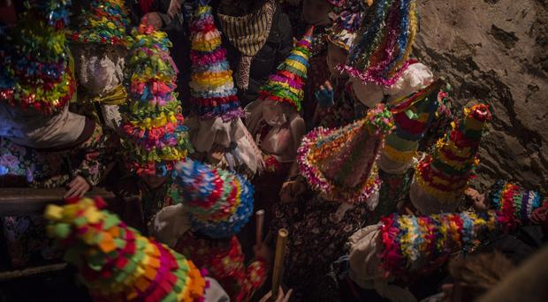 A group of participants called ''Txatxus'' take part in the ancient rural carnival (AP)