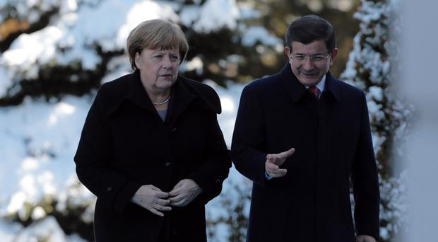 German Chancellor Angela Merkel and Turkish prime minister Ahmet Davutoglu in Ankara (AP)