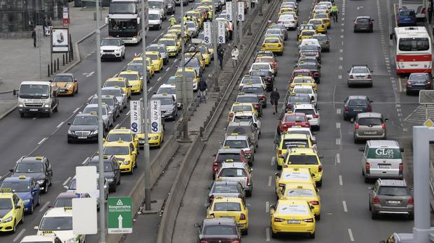 Taxi drivers block a key road near Prague's Central Station (AP)