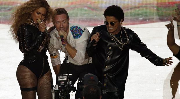 Coldplay singer Chris Martin, centre, with Beyonce and Bruno Mars at the Superbowl half-time show (AP)