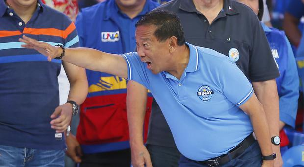 Philippine Vice President and now opposition presidential candidate Jejomar Binay greets his supporters (AP)