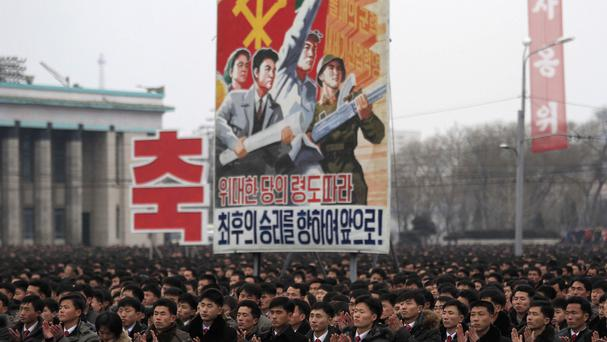 North Koreans gather at Pyongyang's Kim Il Sung Square to celebrate a rocket launch on February 7 that was condemned around the world. (AP)