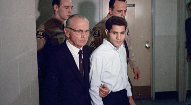 Sirhan Sirhan, right, with his lawyer in 1968 (AP)