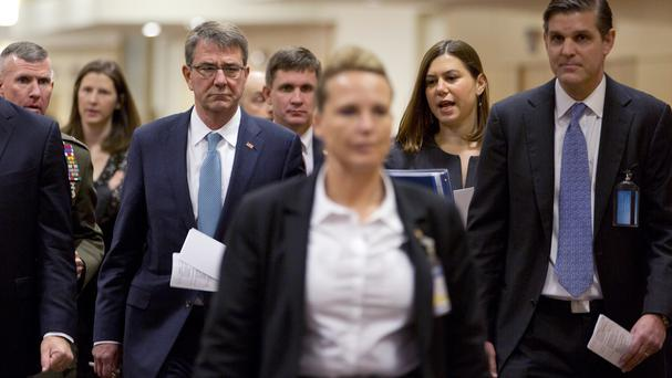 Ash Carter walks to a meeting at Nato headquarters in Brussels (AP)