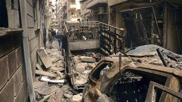 A street hit by shelling in Aleppo's predominantly Christian and Armenian Suleimaniyeh neighbourhood (SANA/AP)
