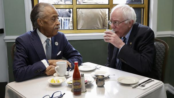 Tea and sympathy - Democratic presidential candidate Bernie Sanders, right, with the Rev Al Sharpton at a breakfast meeting in Harlem, New York City (AP)