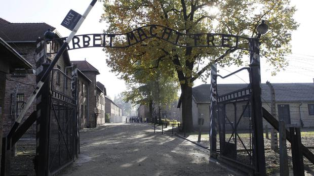 The entrance gate of the former Nazi death camp at Auschwitz (AP)