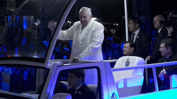 Pope Francis receives a rapturous welcome as he arrives in Mexico City (AP)