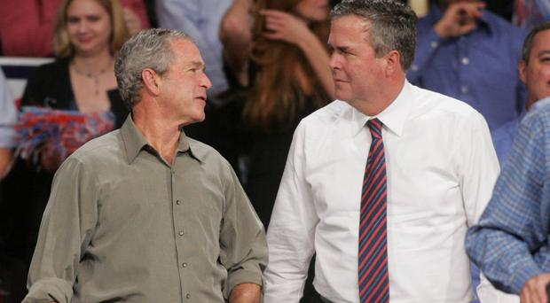 Former president George Bush, left, pictured with Jeb in 2006, will be campaigning for his younger brother in South Carolina (AP)