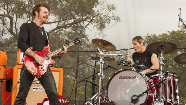 Jesse Hughes, left, and Jeff Friedl of Eagles of Death Metal perform in Chicago. in September last year (AP)