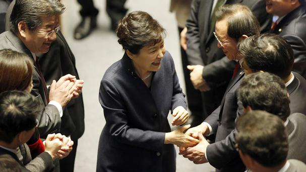 President Park Geun-hye is greeted by politicians after delivering her speech at the National Assembly in Seoul (AP)