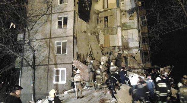 Emergency and rescue workers search the debris of a five-storey apartment building after a powerful natural gas explosion in Yaroslavl, Russia (PA/AP/Russian Emergency Ministry Yaroslavl Branch Press Service)