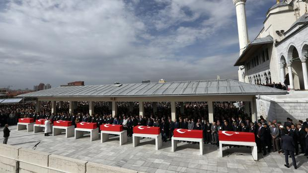 Turkish army commanders, ministers and family members attend funeral prayers for some of the 28 victims (AP)