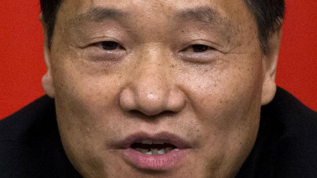 Xiao Gang is stepping down as China's senior securities regulator (AP)