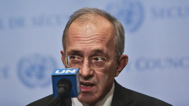 Turkey's UN ambassador Yasar Halit Cevik speaks during a press conference after Security Council meetings on Syria (AP)