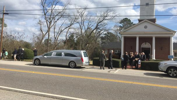 Family members leave the funeral of Harper Lee