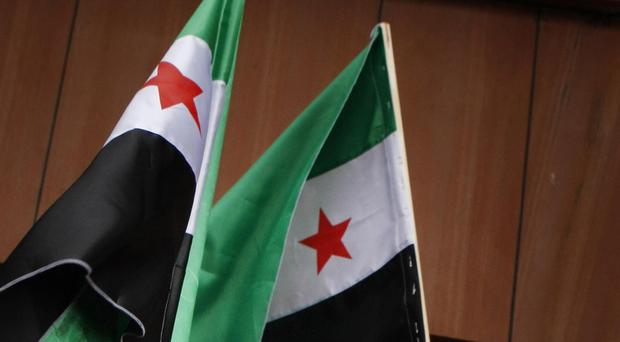 Two explosions in the central Syrian city of Homs have killed at least 32 people and wounded dozens more