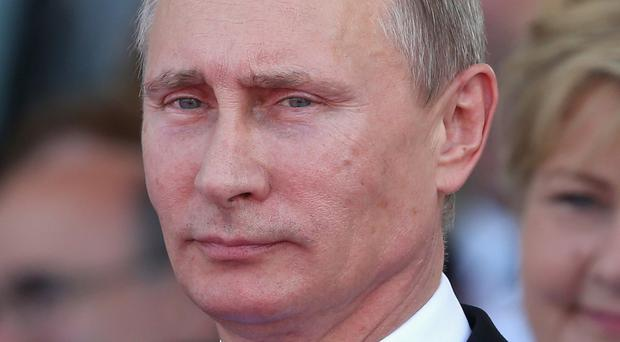 Russian president Vladimir Putin spoke to the Syrian leader on the telephone, reports say