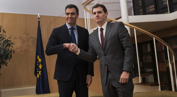 Spain's Socialist Party leader Pedro Sanchez, left, shakes hands with Ciudadanos Party president Albert Rivera (AP)