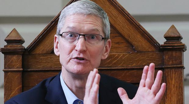Apple chief executive Tim Cook says software created to unlock the iPhone would be the equivalent of cancer