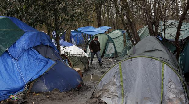 A court ruled that French authorities can evict migrants from their tents (AP)
