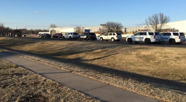 Police vehicles line the road after reports of the shooting at an industrial site in Hesston, Kansas (KWCH-TV/AP)