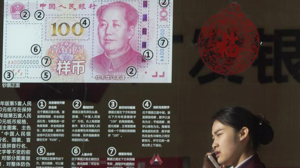 China faces pressure to reassure world markets over how it is steering its slowing economy and managing its currency (AP)