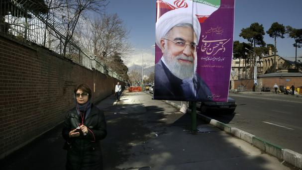 An electoral banner backing President Hassan Rouhani hangs outside the former US embassy in Tehran (AP)