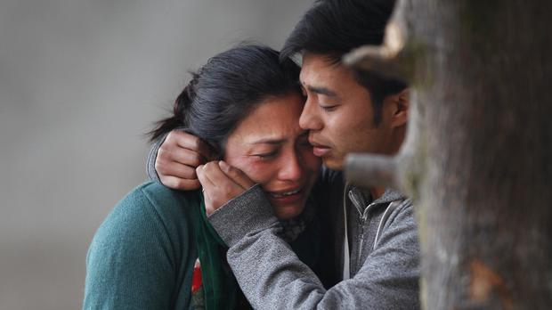Relatives of victims of a plane crash in a remote Himalayan region of central Nepal in which 23 people were killed (AP)